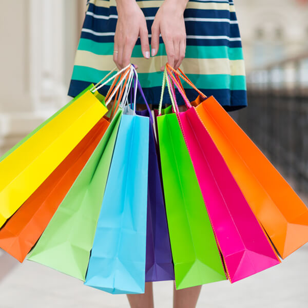 lady holding colorful shopping bags